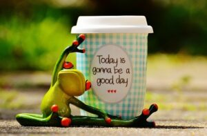 "Frog hugging a coffee cup saying ""Today is gonna be a good day"""
